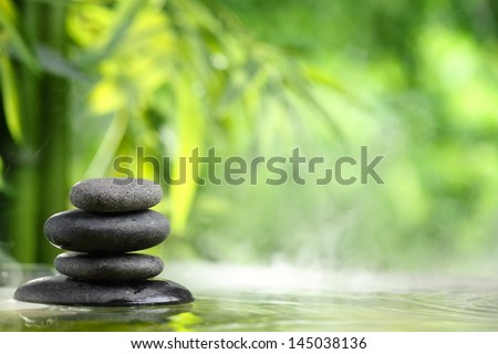 Spa still life with zen stone and bamboo - stock photo