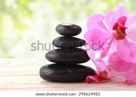 Spa still life with zen stone and orchid flower - stock photo