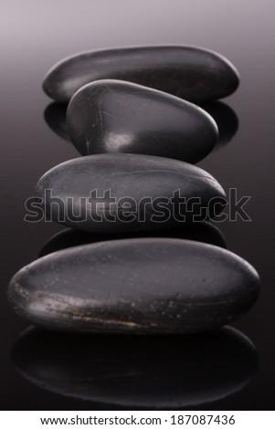 Spa stone arrangement on black surface - stock photo