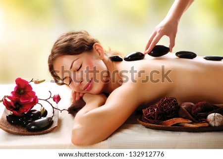 Spa Stone Massage. Beauty Treatments. Spa Hot Stones - stock photo