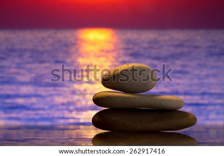 Spa stones at sunset - stock photo