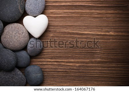 Spa stones in te wooden background. - stock photo