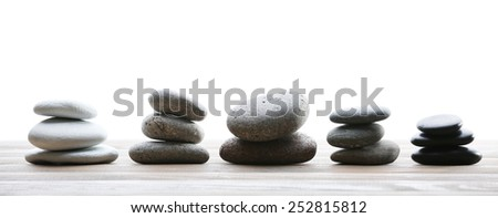 Spa stones on table on light background - stock photo