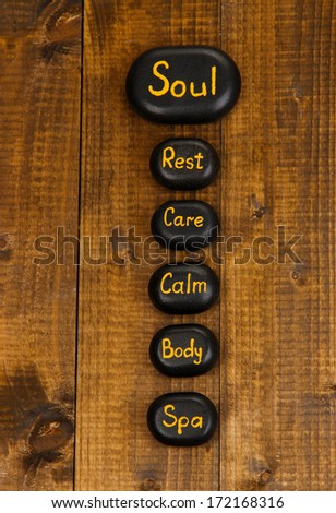 Spa stones on wooden background - stock photo
