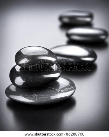 Spa Stones over Black - stock photo