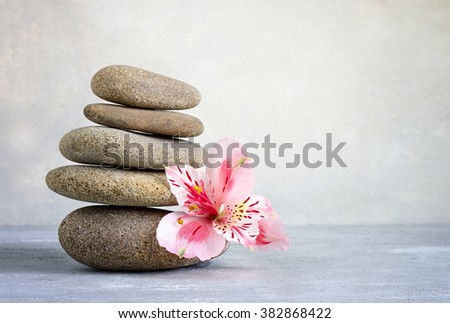 Spa stones stack with a flower, spa concept - stock photo
