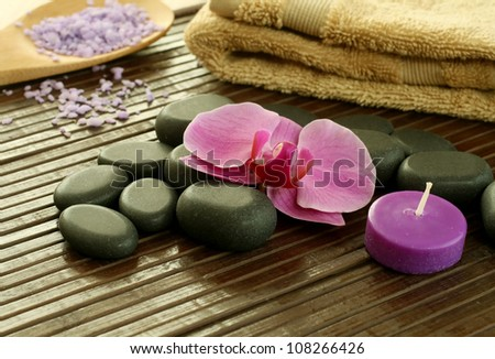 spa stones, towel  and orchid flower - stock photo