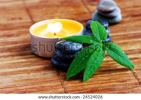 spa stones with leaf and candle