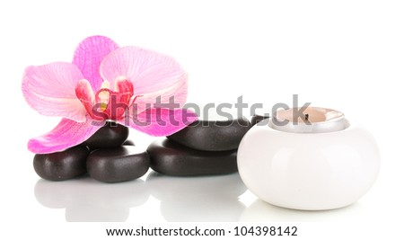 Spa stones with orchid flower and candle isolated on white - stock photo