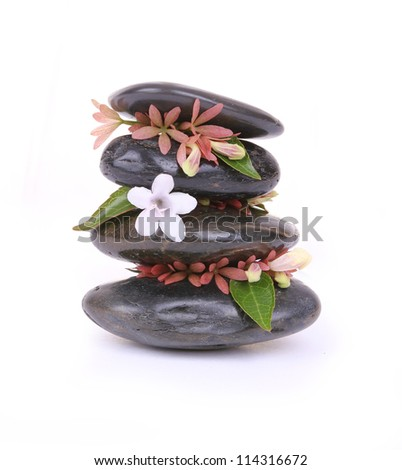 spa stones with white flower isolated on white - stock photo