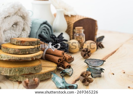spa stuff, cinnamonand flower with towel on wood - stock photo