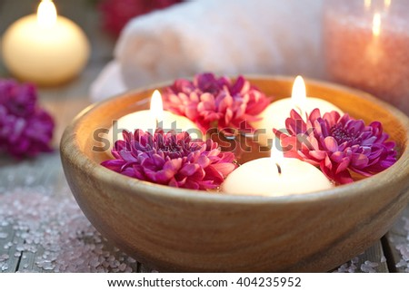 Spa theme with candles and flowers - stock photo