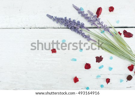 Spa theme with Salt and flowers on wooden background