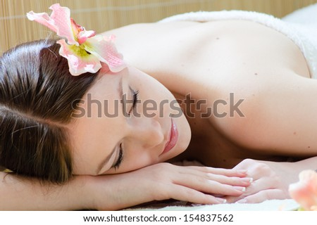 Spa time: Young beautiful woman relaxing in spa salon - stock photo
