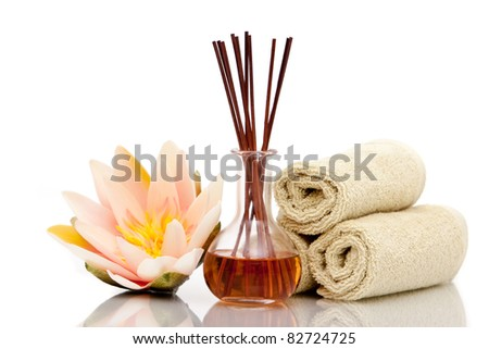 Spa towels and essential oils on white background - stock photo