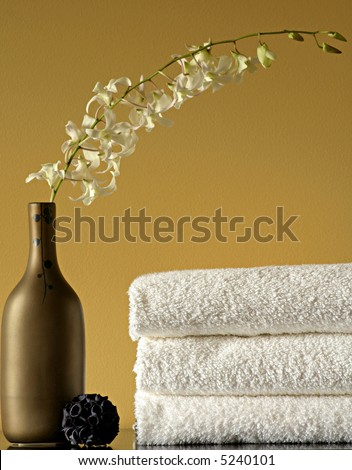 Spa Towels and Vase with Flowers