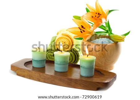 Spa towels with candles isolated on white - stock photo