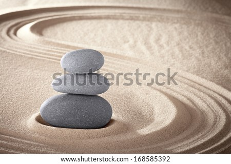 spa treatment concept japanese zen garden stones tao buddhism conceptual for balance harmony relaxation meditation wellness background harmony and purity stone stack in sand pattern spiritual elements - stock photo
