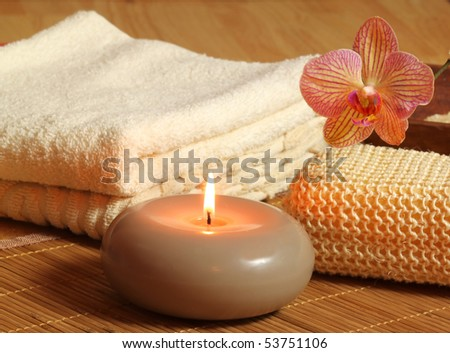Spa treatment for beauty and relax. Candle and orchid flower - stock photo