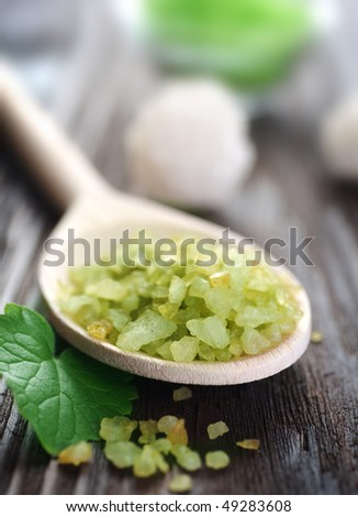 Spa treatment-scented bath salt - stock photo