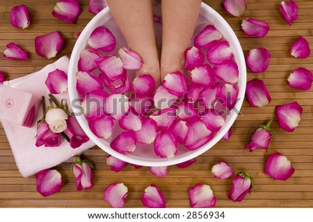 Spa Treatment with aromatic roses, petals, and candle - stock photo