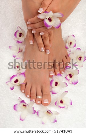 Spa treatment with beautiful exotic orchids - stock photo