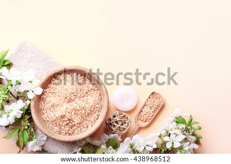 Spa treatment with blooming branch on light background