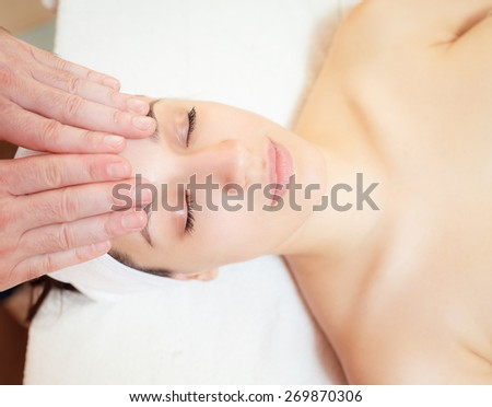 spa treatments. facial massage beautiful girl