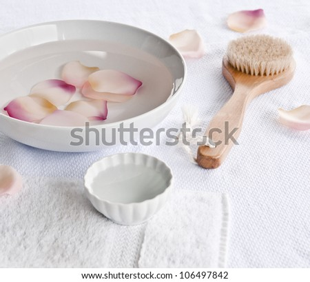 Spa with pink rose petals - stock photo