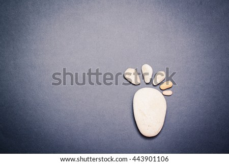 Spa with stone, rock for zen, beauty, balance, wellness on dark background. Concept of health, therapy, relaxation. Massage treatment for tranquil and harmony, relax. - stock photo
