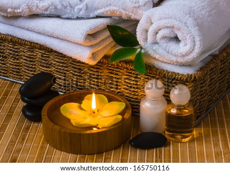 Spa with towels with a candle and other accessories - stock photo