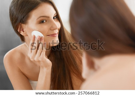 Spa Woman. Beautiful Woman Cleaning Her Face. Cosmetology and Make up. Skincare - stock photo