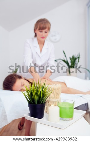 Spa Woman. Beauty Treatment. Beautiful Healthy Caucasian Girl Relaxing On Massage Table Before Procedure In The Spa Salon. Masseur Going To Massage Her Back. Body Care. Skin Care, Wellness, Wellbeing - stock photo
