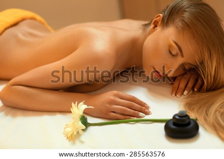 Spa Woman. Blonde Getting Recreation Massage in Spa Salon. Wellness Concept