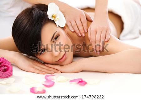 Spa Woman. Close-up of a Beautiful Woman Getting Spa Treatment. Massage - stock photo
