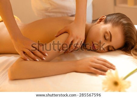 Spa Woman. Close-up of a Beautiful Woman Getting Spa Treatment. Massage