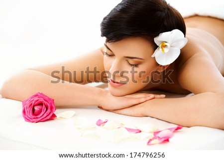 Spa Woman. Close-up of a Beautiful Woman Getting Spa Treatment. Spa Salon