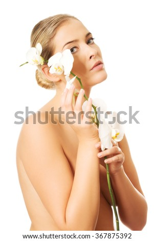 Spa woman holding white orchid flower - stock photo