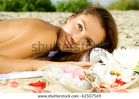 spa woman relaxing on the sea coast - stock photo
