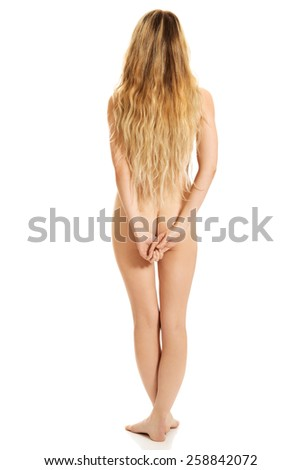 Spa woman standing back to camera - stock photo