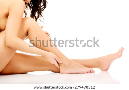 Spa woman touching her slim legs.