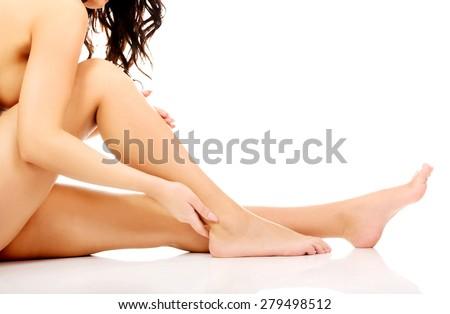 Spa woman touching her slim legs. - stock photo