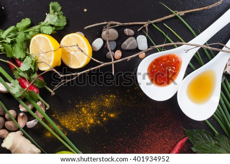 space background spices spices ginger onion lemon chilli sauce products ingredients turmeric black top food - stock photo
