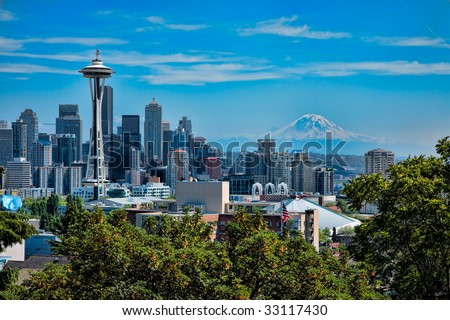 Space Needle with Seattle and Mt. Rainier in the background in abstract. - stock photo