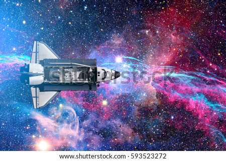 Space Shuttle flight over space stars, galaxies and nebula. Elements of this image furnished by NASA.