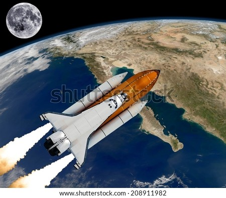 Space shuttle rocket launch Baja California spaceship background. Elements of this image furnished by NASA. - stock photo