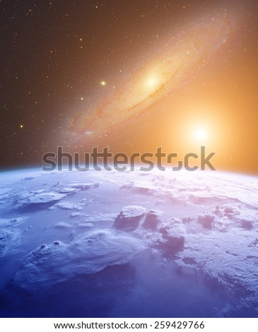 Space sunrise in a distant quasar galaxy. Elements (Earth) of this image furnished by NASA. Andromeda galaxy photographed through my telescope. Digital illustration. - stock photo