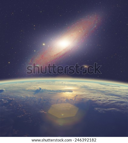 Space sunrise with Andromeda galaxy. Elements of this image furnished by NASA. - stock photo