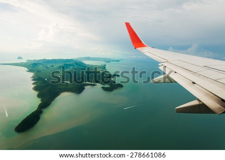 space view from airliner window with blue sky and clouds - stock photo