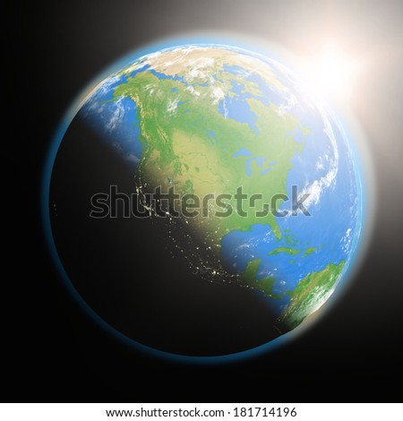 Space view of the sun rising over North America on blue planet Earth. Elements of this image furnished by NASA. - stock photo